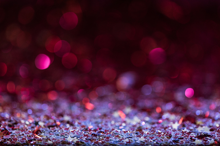 christmas background with pink and silver shiny confetti stars