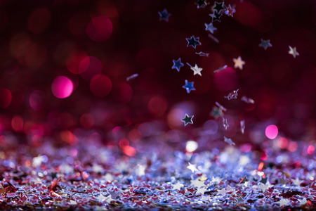christmas background with falling pink and silver shiny confetti stars Stock Photo