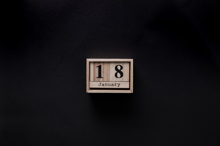 top view of wooden calendar isolated on black Stockfoto - 111850926