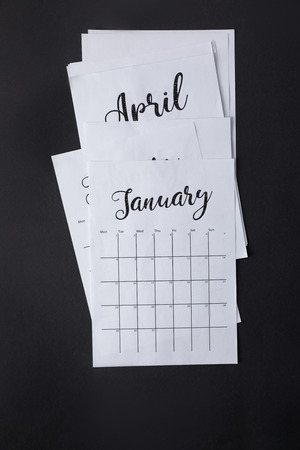 top view of arranged parts of paper calendar isolated on black Stockfoto - 111851400