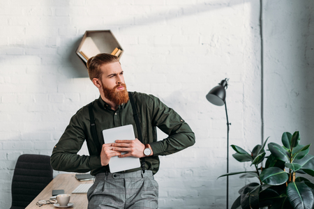 businessman holding tablet and looking away Stock Photo