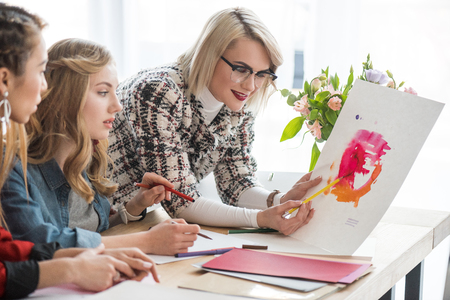 fashionable magazine editors working with sketches in modern office Stockfoto