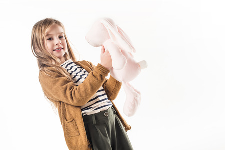beautiful little child with soft toy bunny isolated on white Standard-Bild - 111858531