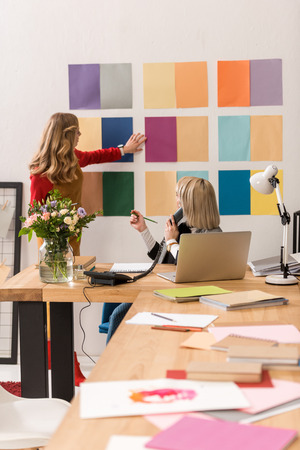 fashionable magazine editors working with color palette in modern office Stockfoto