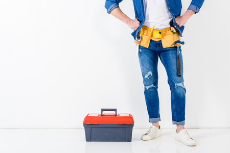 cropped image of worker standing near tools box