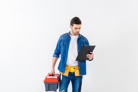 worker looking at clipboard isolated on white