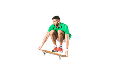 handsome young man jumping with skateboard isolated on white Stockfoto
