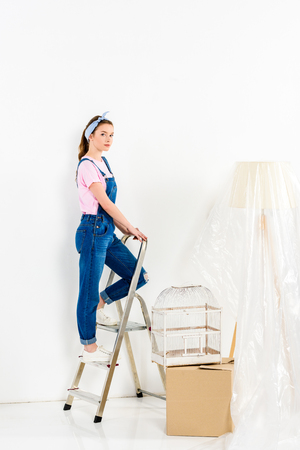girl standing on ladder and looking at camera 스톡 콘텐츠
