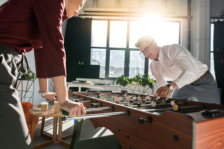 happy business people playing table football at modern office Stok Fotoğraf