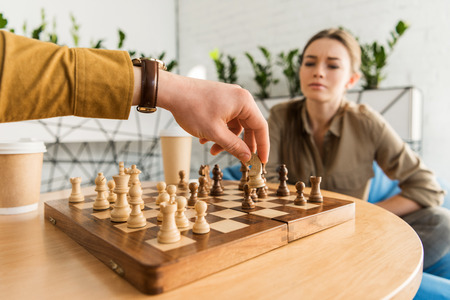 young woman playing chess with her boyfriend