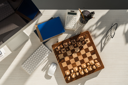 top view of chess board at workplace with computer Stok Fotoğraf