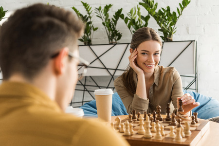 young woman playing chess and flirting with opponent Stok Fotoğraf