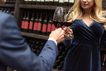 cropped shot of couple clinking glasses of wine Stock Photo