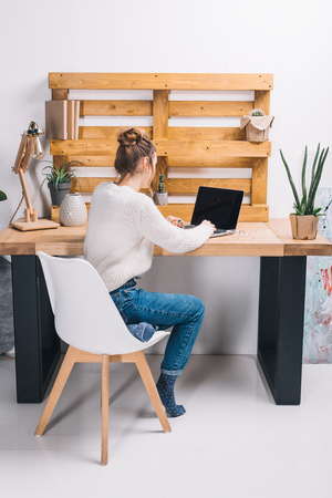 girl working with laptop in modern office