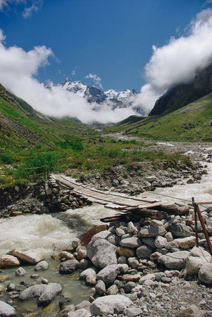 wooden bridge and mountain river, Russian Federation, Caucasus, July 2012 Standard-Bild - 111950886