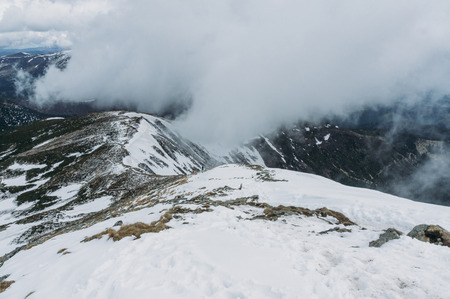 Amazing landscape with scenic Carpathians peaks covered with snow, Ukraine, May 2016 스톡 콘텐츠