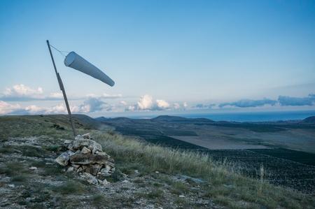 Beautiful mountainous landscape with windsock waving in Crimea, Ukraine, May 2013 Imagens - 111952154