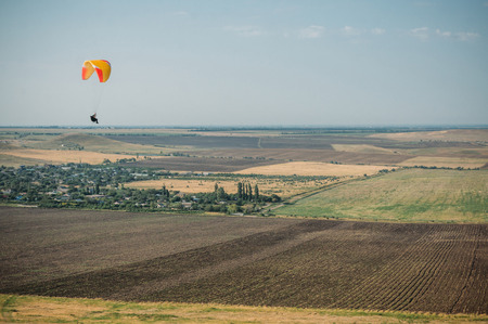 Parachute in the sky over field in hillside area of Crimea, Ukraine, May 2013 免版税图像