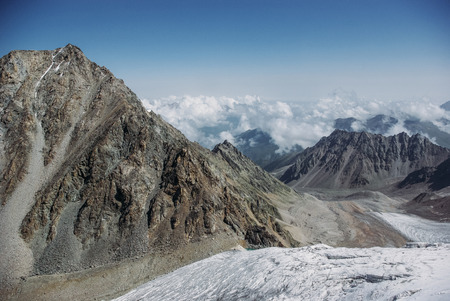 amazing view of mountains landscape with snow, Russian Federation, Caucasus, July 2012 Фото со стока