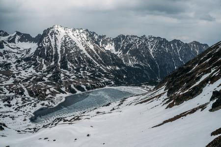 Winter landscape with scenic frozen lake, Morskie Oko, Sea Eye, Tatra National Park, Poland