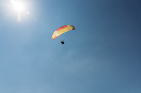 Parachutist flying in blue clear sky, Crimea, Ukraine, May 2013 Standard-Bild - 111987136
