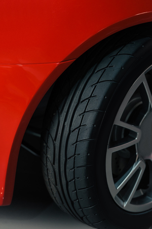 cropped shot of wheel of red sport car Stock Photo