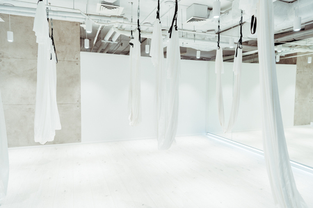 Light white spacious studio equipped for antigravity yoga