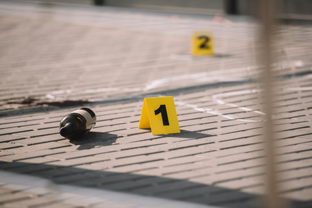 Close up view of crime scene with chalk line and numbers