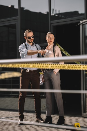 Male detective showing something to partner