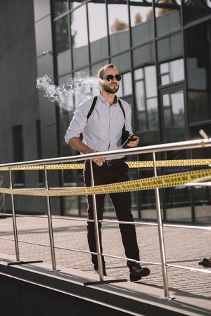 Smoking male detective walk through the crime scene Stok Fotoğraf