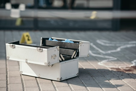 Investigation tool box standing open near chalk line 版權商用圖片