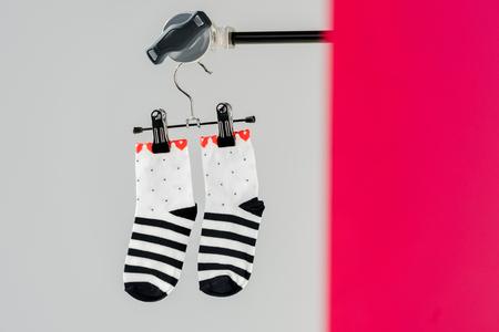 Pair of black and white cotton socks on hanger Stockfoto