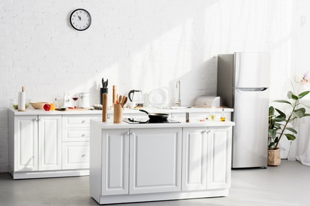 Kitchen minimalist interior with cooking supplies and devices