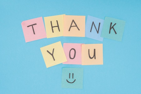 colorful sticky notes spelling thank you isolated on blue background Stock fotó - 112156417