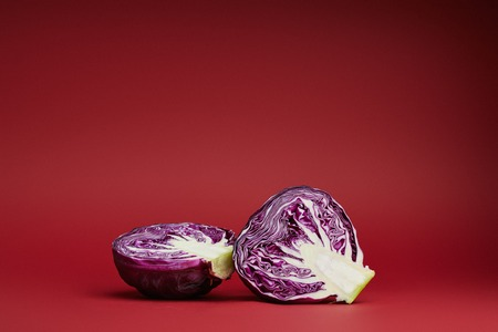 fresh ripe organic sliced purple cabbage on red background