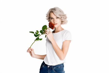 Beautiful blonde woman holding red flower isolated on white Standard-Bild - 112158303
