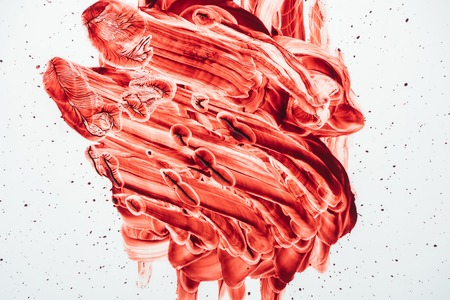 top view of blood smeared with hand on white
