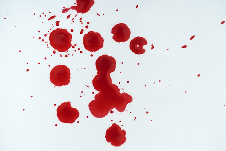 top view of white surface covered with blood blots Stock Photo
