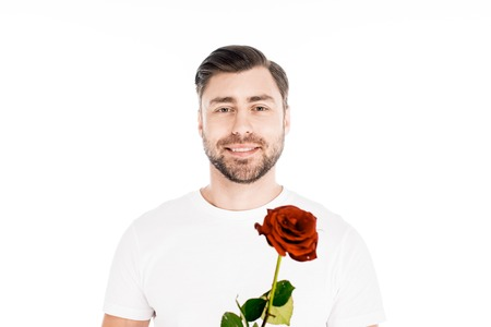 Handsome smiling young adult man with red rose isolated on white Standard-Bild - 112158779