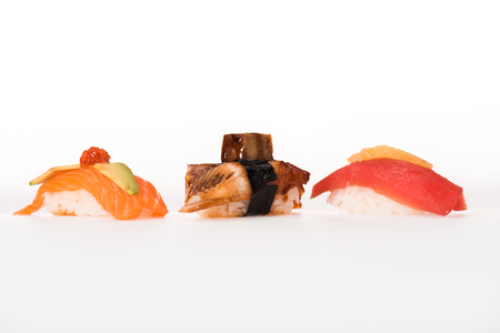 Three nigiri sushi isolated on white Stockfoto