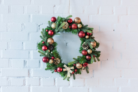 Christmar wreath on the background of white brick wall