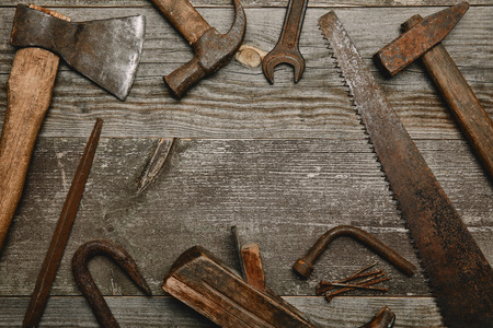 Top view of various tools on wooden background Stock Photo - 112160995