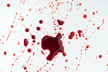 top view of white surface covered with blood droplets Stock Photo