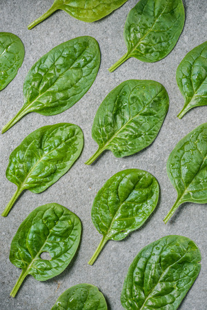 Flat lay of organic and wet spinach leaves Stock Photo