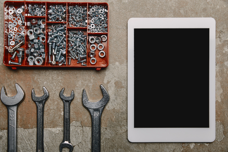 Flat lay with digital tablet and different carpentry tools  on the background of old  surface Stock Photo - 112161262