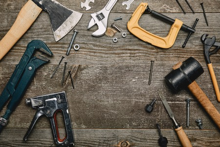Top view of set of tools on wooden background