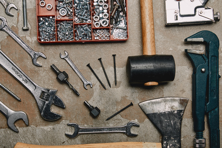 Flat lay with set of carpentry tools on old background