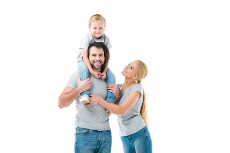 Lovely family, father carring his son on the shoulders isolated on white Stock Photo
