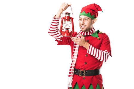 smiling man in christmas elf costume holding red lantern isolated on white
