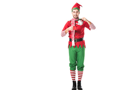 happy man in christmas elf costume holding red cup and metal kettle isolated on white
